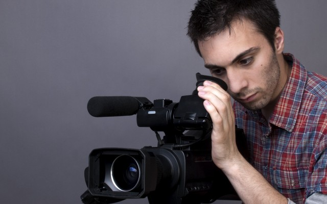 young-man-with-video-camcorder-l